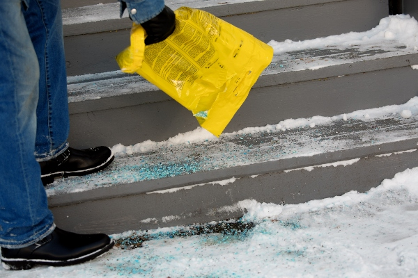 A home or business owner can spread safe rock salt on their pavement without hurting their yard.