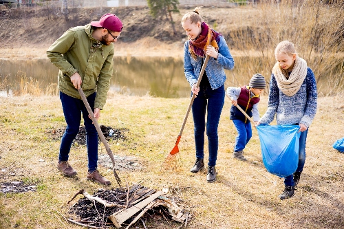 A family gets ready for the next season with a spring yard clean up.